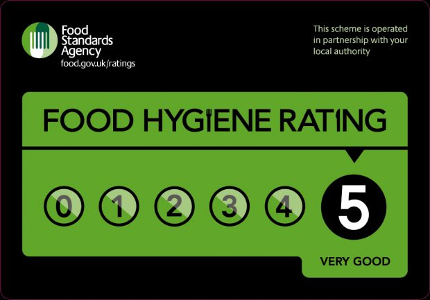 A food hygiene rating sticker showing a score of 5