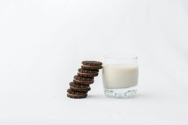 Decorative only - 4 cookies leaning against a glass of milk