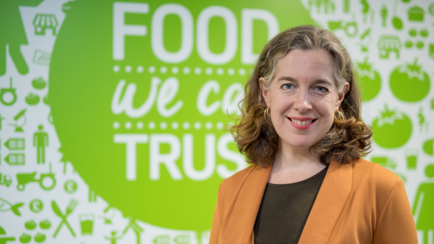 Emily Miles, Chief Executive of the Food Standards Agency, in front of Food We Can Trust sign